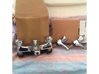Bathroom tap set , new in boxes ,bath mixer with shower head and par of matching basin taps .