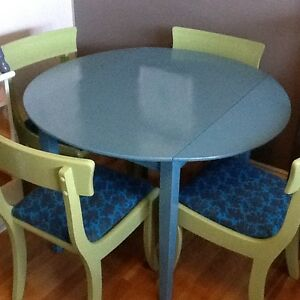 Blue wood table w/4 green chairs with fabric seats
