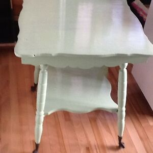 Green antique table with claw feet