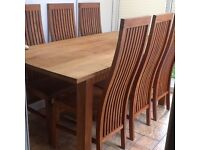 Solid wood dining table & six chairs.