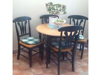 Extendable kitchen/dining table with 4 chairs