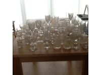 60 plus glasses of various types. Drinking and wine mixed