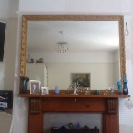 Large bevilled glass mirror with gilt edge.