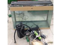 2 fish tanks 1 on a cabenet plus heaters filters bog wood ,rocks and other items selling in one lot