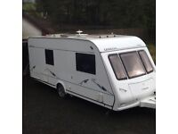 Compass Omega 540 2006 with motor mover, L shaped lounge and fixed transverse bed