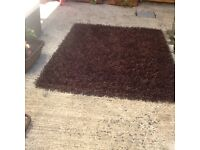 6+4 foot brown spaghetti rug in very good condition