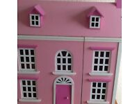 Dolls house complete with all the furniture needs some tlc that's reflected in the price
