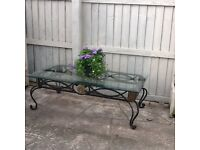Wrought iron coffee table with heavy plate glass top