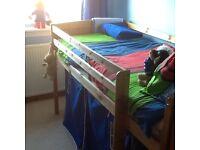 Single solid pine mid sleeper bed.