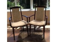 Carver chairs, mahogany, cream upholstery.