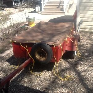 Low profile utility trailer for small car towing. 3' X 5'