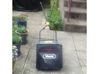 Small lightweight hand push lawnmower. WEBB H12R-A. Ideal for those with a small lawn.