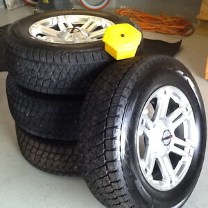 Almost new set of Blizzaks and rims for Toyota Tundra