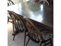 Ercol solid wood dining table and 5 chairs