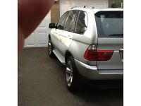 BMW X5 immaculate for year,full service history,new mot,sat nav,tv,cd multi changer,met silver