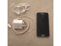 Samsung S6 Galaxy with earphones and charger