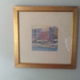 Painting in gold frame of Seaside boats