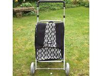 A high quality four wheeled shopper/walker UNUSED with detachable bag