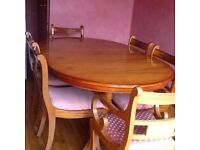 Period yew veneer extening dining room table and 6 chairs