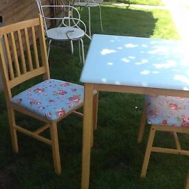 Table and 2 chairs painted in duck egg chairs covered in Cath kidston material