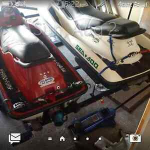 Pair of Seadoos on double trailer, 3 seat GTX, and X4 race XP