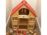 Wooden dolls house with all the orional furniture and dolls plus extra garage and car
