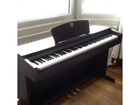 Yamaha Clavinova CLP-115 piano with various optional sounds.