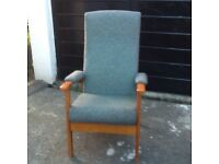 Arm chair, adjustable back, green pattern material.