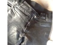 Leather motorbike jacket and leather trousers