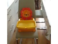 Fisher Price Lion Booster Seat. Fits securely almost all dining chairs and adjusts as child grows.