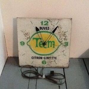 Horloges publicitaires et thermomètre