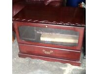Mahogany TV cabinet with glass front and two compartment areas