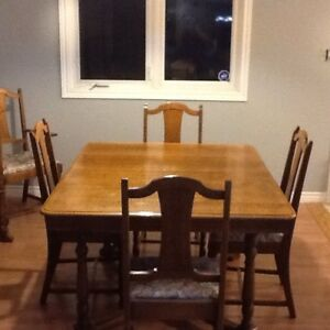 Solid wood antique dining room table & hutch