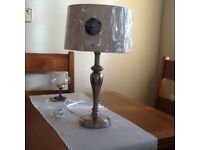 Brushed satin table lamp with shade.