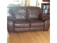 Three matching 2-seater chocolate brown leather sofas