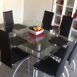 Dining Table 6 chairs , Glass / silver and black chairs Melton Melton Area Preview