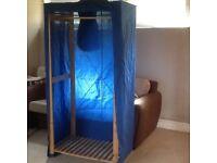 Blue fabric wardrobe clothes rail.