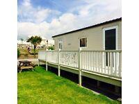 Trecco bay three bedroom caravan with veranda opposite park