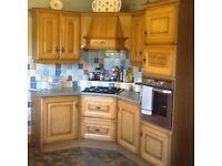 Oak Kitchen Units and integrated fridge freezer, gas hob and eye level pven