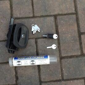 Caravan door handle with higher security lock fitted