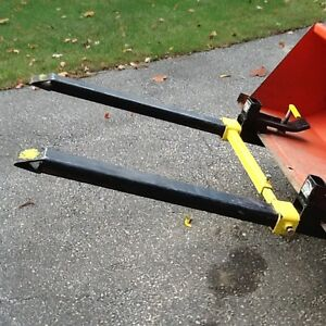 Compact tractor clamp forks for bucket