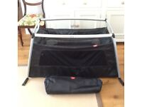 Phil and Teds Traveller Travel Cot complete with Phil and Teds travel bag. As new.