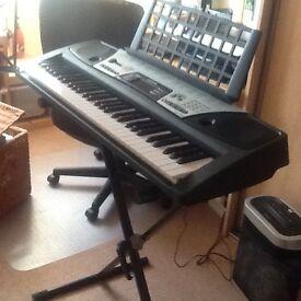 Yamaha EZ 150 Electric Keyboard plus keyboard stand