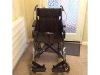 Manual wheelchair with footrests in excellent condition