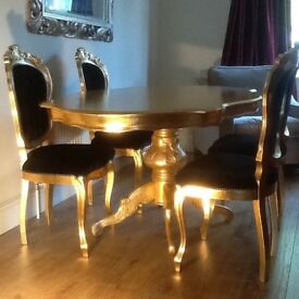 6 seater dining table + 4 chars upholstered in black 'Jab' fabric. 1 carver available extra.