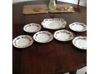 Six side plates and 1 bread and butter plate