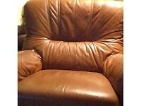 Three piece tan leather suite.