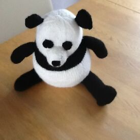 Black and white hand knitted panda