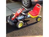 Kids pedal go kart, red. Black any yellow, well used but still works a treat. Kids now too big
