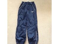Immaculate NIKE navy tracksuit bottoms, age 8-10 yrs